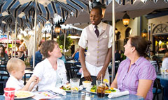 Guests Enjoying Outdoor Dining at Cafe Orleans