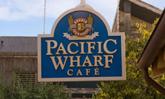 Directional Signs in the Shape of Fish Pointing Towards Pacific Wharf Caf