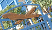 A pair of monorails sculpted on the top of the pool gate