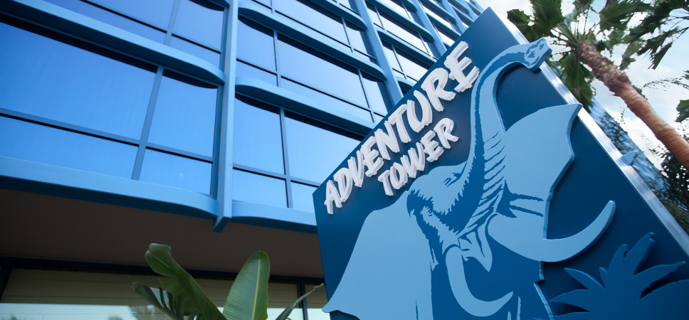 The Adventure Tower sign with an illustration of a safari-style elephant.