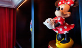A statue of Minnie Mouse sits on the shelf.