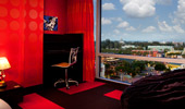 The The red, yellow and black-themed bedroom provides a panoramic view over the Resort.