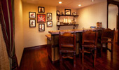 The Suite's wet bar with framed pirate portraits.