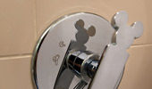 Faucet fixtures in the shape of a famous mouse.