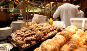 Fresh baked goods are part of the buffet.