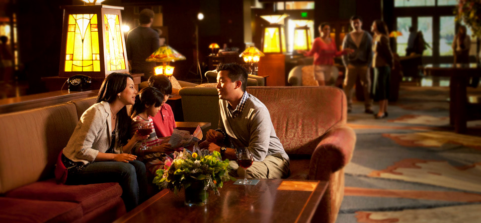 A family discusses the day while seated on the cozy lobby couches.