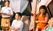 A family of 4 enjoys poolside service inside the rented cabana.