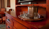 Water glasses, ice bucket and tray placed on the gorgeous media console.
