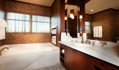 White marble bath tub and counter in the Mount Whitney Suite