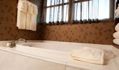 An additional bath, with elegant tub, in the Mount Whitney Signature Suite 