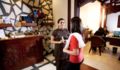 A Mandara Spa attendant discusses the available services with a Guest.