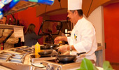 A chef cooks up his creations at the egg and omelet station.