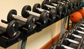 Rows of free weights at the Fitness Center, so you can stay in shape during your stay.