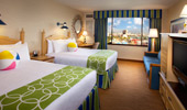 2 queen beds with beach-themed decor at Disney's Paradise Pier Hotel