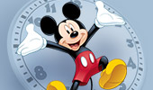 Mickey Mouse stretching his hands across a clock face is the logo for Limited Time Annual Passholder Magic