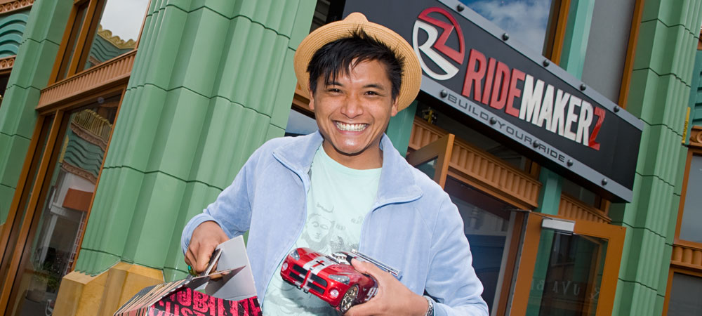 Man with Model Car in Front of RIDEMAKERZ